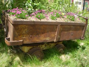 An old ore cart that has been turned into a planter.