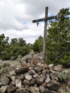 Empty cross with rosaries.