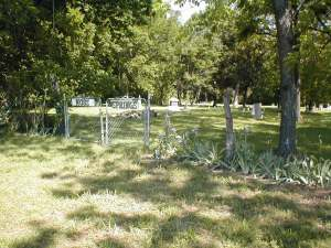 Entrance to Moss Springs Cemetery, Jasper County, Missouri. Taken May 2001
