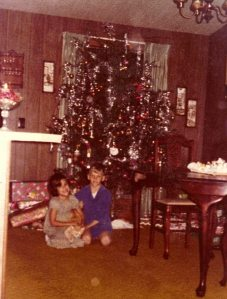 Brian, Debbie and Louie the cat in front of our tree in Missouri--Taken Christmas 1977