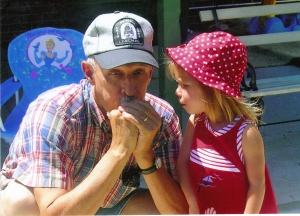 Howard teaching Brandon's daughter, Trinity, how to make a dove call. Taken in Broomfield, Colorado about 2006.