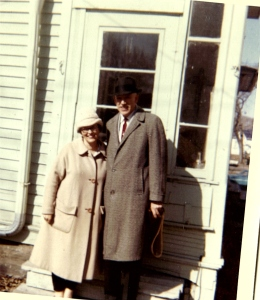 Howard's parents: Mildred Lee Warfield Beall (1917-2007) and Rev. Edward Leyburn Beall (1907-1992) standing behind their house in Cedar Rapids, Iowa, Winter 1963.