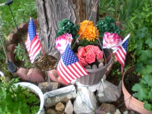 Flags, flowers and a Service Marker in Brian's Garden